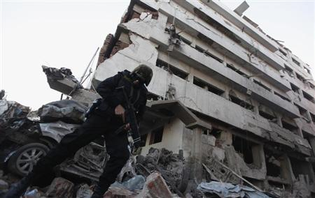 A riot policeman stands outside building of Directorate of Security after explosion in Egypt's Nile Delta town of Dakahlyia
