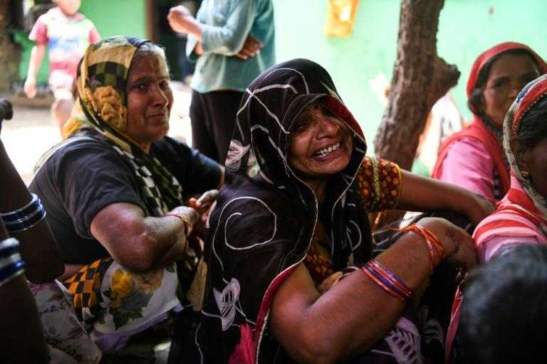 Relatives mourn 24-year-old Sunil Kumar who was among 24 killed in the small town of Kheragarh on the outskirts of Agra