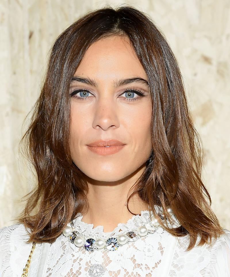 <p>Tracing a thin stripe of eyeliner just above the crease of your lids creates the illusion of an upward sweep, says makeup artist Jo Baker. Not to mention it looks supercool, as shown here on Alexa Chung. </p>