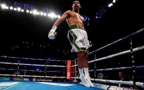 Amir Khan celebrates winning the fight  - Credit: REUTERS