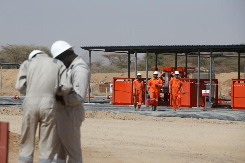 FILE PHOTO: Workers are seen at Tullow Oil's Ngamia 8 drilling site in Lokichar