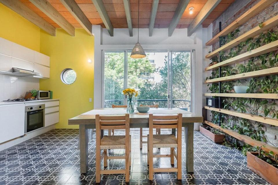 """This Airbnb offers indoor-outdoor living at its finest, with floor-to-ceiling glass doors in the kitchen, living room, and bedroom, leading out to a variety of balconies. There's also an ivy-covered wall in the eat-in kitchen, to really bring the tree-lined streets of Roma Norte into the apartment. It's walkable to many of the city's most popular attractions and restaurants, making it a perfect place to spend a relaxing evening after a day on your feet. $82, Airbnb (Starting Price). <a href=""""https://www.airbnb.com/rooms/plus/3916192"""" rel=""""nofollow noopener"""" target=""""_blank"""" data-ylk=""""slk:Get it now!"""" class=""""link rapid-noclick-resp"""">Get it now!</a>"""