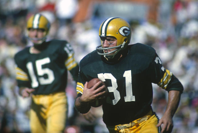 Green Bay Packers fullback Jim Taylor carries the ball during a 1965 game at Lambeau Field. Taylor died Saturday at the age of 83. (Getty)