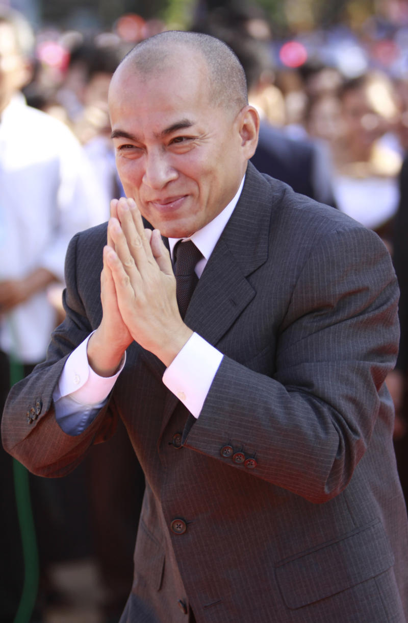 In this May 21, 2011 photo, Cambodia's King Norodom Sihamoni greets wellwishers during an annual royal plowing ceremony in Phnom Penh, Cambodia. The king may be heir to a royal line trailing back some 2,000 years, but he always seemed more suited to the arts scene in Europe, than the rough and tumble politics of his homeland. Now, close aides and experts say, he has become figuratively, and more, a prisoner in his own palace. (AP Photo/Heng Sinith)