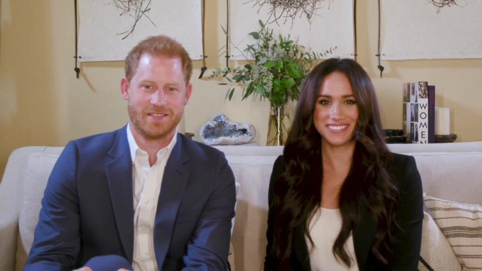 This screengrab released by Time shows Harry and Meghan, the Duke and Duchess of Sussex, hosting a special Time100 talk Tuesday, Oct. 20, 2020, focusing on the digital world. They said the idea is to help make online communities safer and free of misinformation. (Time via AP)