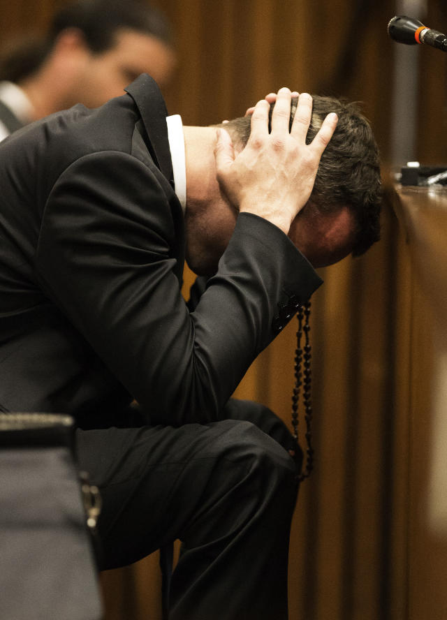 Oscar Pistorius, puts his hands to his head while listening to evidence from a witness speaking about the morning of the shooting of his girlfriend Reeva Steenkamp, in court on the fourth day of his trial at the high court in Pretoria, South Africa, Thursday, March 6, 2014. Pistorius is charged with murder for the shooting death of his girlfriend, Steenkamp, on Valentines Day in 2013. (AP Photo/Marco Longari, Pool)