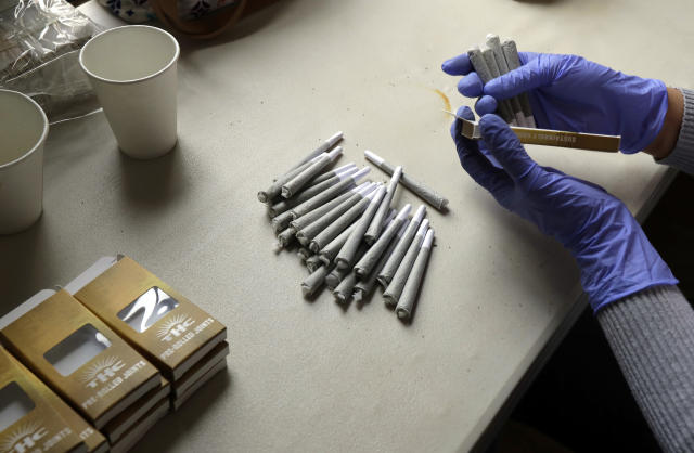 A worker at the Hollingsworth Cannabis Company near Shelton, Wash., packages pre-rolled marijuana joints. (Photo: Ted S. Warren/AP)