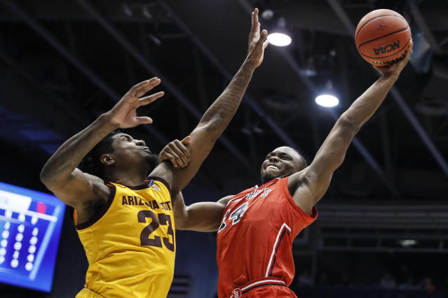 St. John's Mustapha Heron (14) shoots against Arizona State's Romello White (23) during the second half of a First Four game of the NCAA men's college basketball tournament Wednesday, March 20, 2019, in Dayton, Ohio. (AP Photo/John Minchillo)