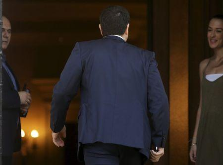 Greek Prime Minister Alexis Tsipras returns at the Maximos Mansion after a meeting with the Defense minister in Athens, Greece, July 2, 2015. REUTERS/Christian Hartmann