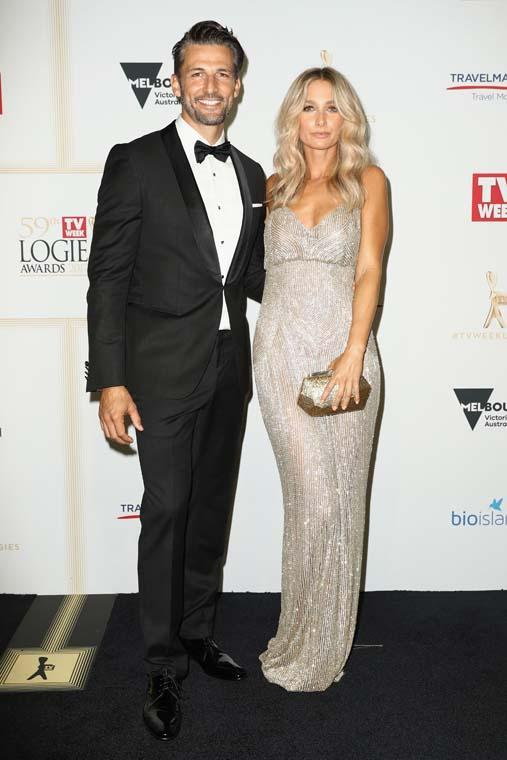 <p>Anna Heinrich channeled her inner gold logie in this glistening column gown by Steven Khalil. She matched it with Stuart Weitzman heels and a simple, gold Mimco clutch. Tim Robards looked as dashing as ever as he suited up in this Hugo Boss tux complete with a pocket square and a black dicky bow.</p>