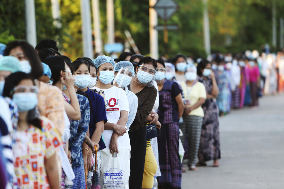 FILE - In this Sunday, Nov. 8, 2020 file photo, voters line up to cast their ballots at a polling station, Sunday, Nov. 8, 2020, in Naypyitaw, Myanmar. A major election monitoring organization says last November's election results in Myanmar were representative of the will of the people, rejecting the military's allegations of massive fraud that served as its justification for seizing power. ANFREL, the Asian Network for Free Elections, said in a 171-page report said procedural safeguards helped make the polling process transparent and reliable. (AP Photo/Aung Shine Oo, File)