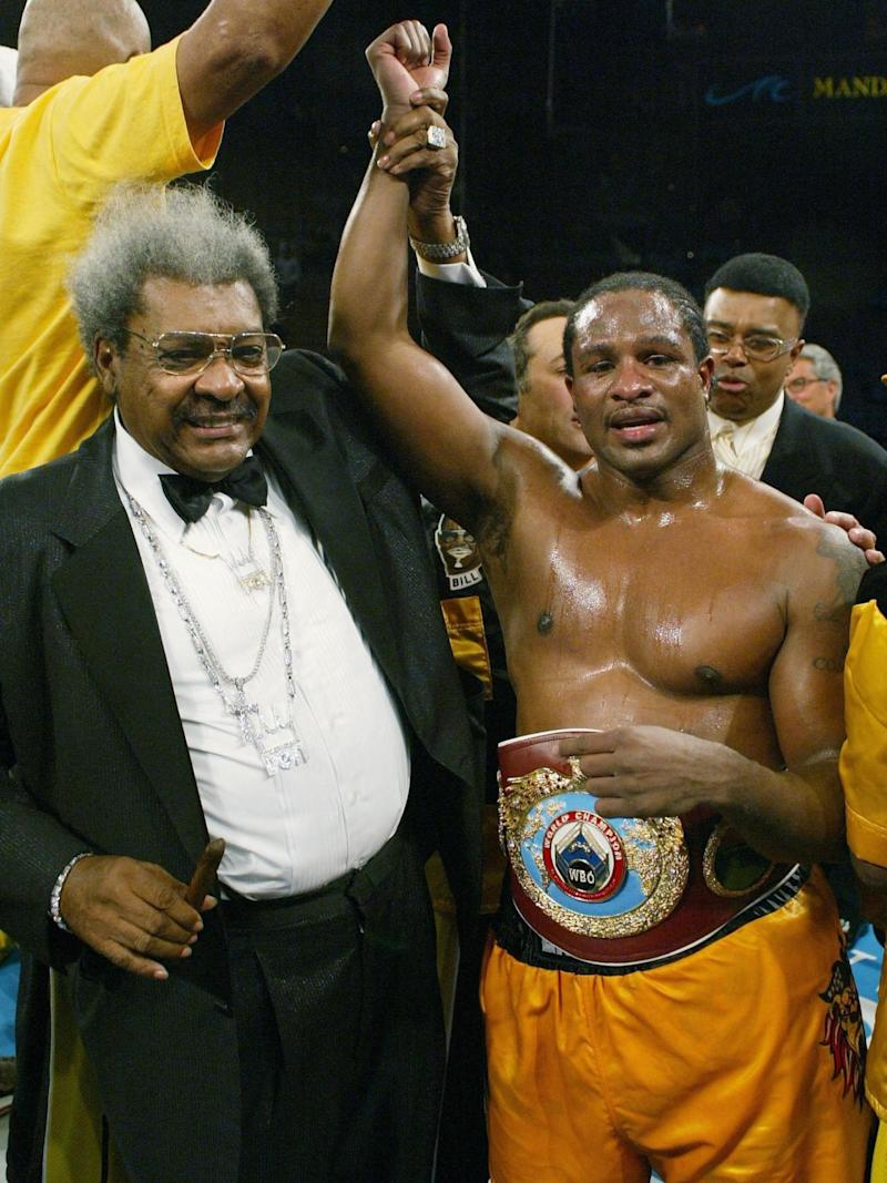 King holds up Brewster's arm after his win over Klitschko (Getty )