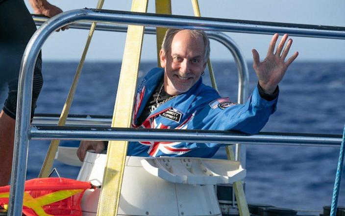 Richard Garriott, a dual British-American national, made sure to wear the same suit that he wore into space, which features both the Union Jack and the American Stars and Stripes.