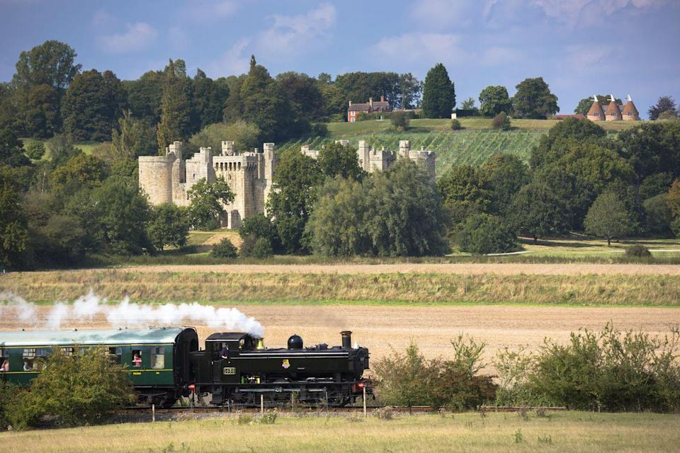 """<p>Moated Bodiam Castle is a short drive from Rye and the perfect spot for a romantic visit. For the most memorable experience, arrive by steam train on the <a href=""""https://www.redescapes.com/tours/stately-homes-of-kent-canterbury-railway-holiday"""" rel=""""nofollow noopener"""" target=""""_blank"""" data-ylk=""""slk:Kent and Sussex light railway from Northiam"""" class=""""link rapid-noclick-resp"""">Kent and Sussex light railway from Northiam</a>. </p><p>This railway's beautifully restored carriages date back to Victorian times and the staff dress impeccably in period outfits to really conjure up that nostalgic feeling.</p><p><a class=""""link rapid-noclick-resp"""" href=""""https://www.redescapes.com/tours/stately-homes-of-kent-canterbury-railway-holiday"""" rel=""""nofollow noopener"""" target=""""_blank"""" data-ylk=""""slk:CHECK OUT RED'S RAIL TRIP"""">CHECK OUT RED'S RAIL TRIP</a></p>"""