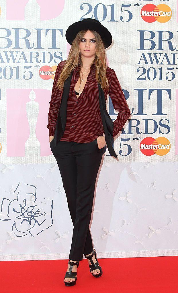 <p>Delevingne channeled her signature 2015 look at her debut BRITs, wearing Yves Saint Laurent, where she presented her Chanel collaborator Pharrell Williams with the 'International Male Solo Artist' award.</p>