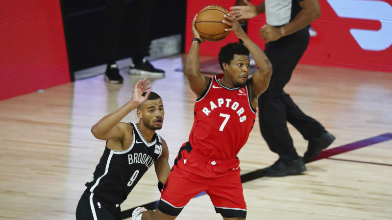 Toronto Raptors guard Kyle Lowry (7) looks to pass while defended by guard Timothe Luwawu-Cabarrot (9) during the second half in Game 3 of an NBA basketball first-round playoff series, Friday, Aug. 21, 2020, in Lake Buena Vista, Fla. (Kim Klement/Pool Photo via AP)