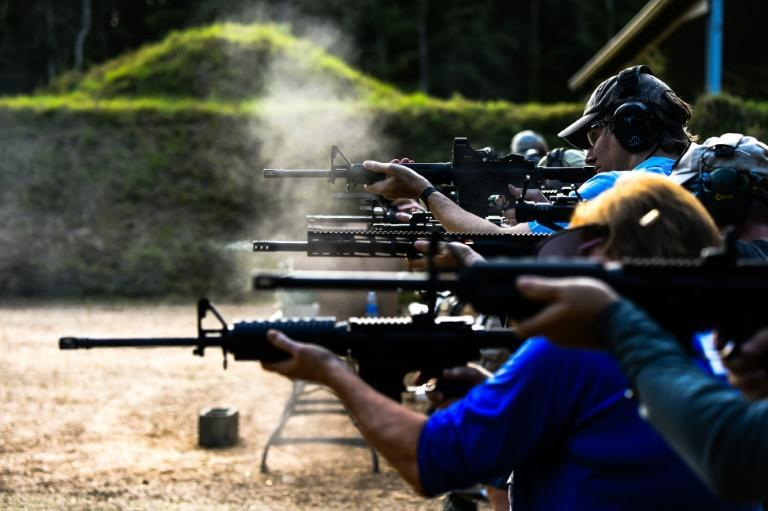 Students fire AR-15 semi-automatic rifles at the Boondocks Firearms Academy in Jackson, Mississippi