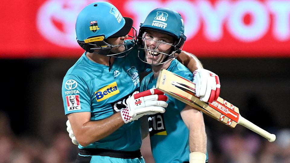 Jimmy Peirson and Joe Burns of the Heat celebrate victory in the Big Bash League Eliminator Final. (Photo by Bradley Kanaris/Getty Images)