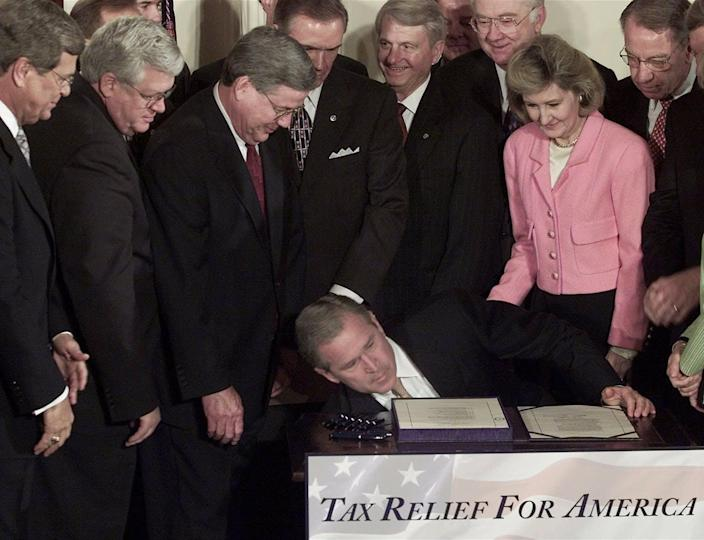 President George W. Bush dropped a pen while signing the 2001 tax cut bill.