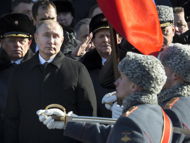 Feb. 23 2018 Russian President Vladimir Putin left attends a wreath-laying ceremony at the Tomb of the Unknown Soldier in Moscow Russia. Putin may look like a winner after an abrupt U.S. decision to pull out