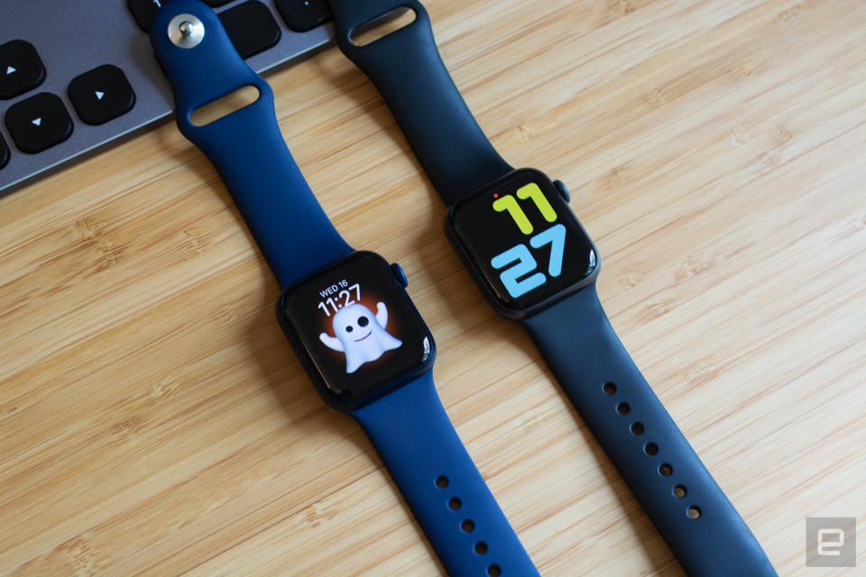 The Apple Watch Series 6 (left) next to the Apple Watch Series 5 (right) on a wooden table.