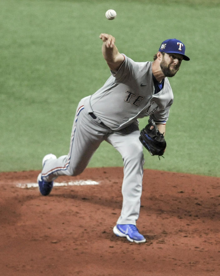 Texas Rangers starter Jordan Lyles pitches to a Tampa Bay Rays batter during the first inning of a baseball game Thursday, April 15, 2021, in St. Petersburg, Fla. (AP Photo/Steve Nesius)