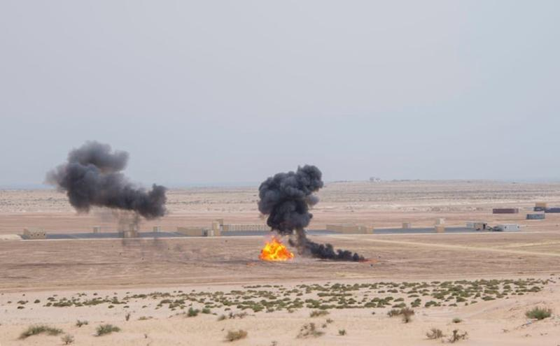 """A handout picture provided by the Saudi Royal Palace on April 16, 2018, shows explosions during the final day of the """"Gulf Shield 1"""" military drills in the eastern Saudi Arabian region of Dhahran (AFP Photo/BANDAR AL-JALOUD)"""