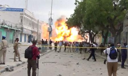 A still from a Reuters TV video shows a secondary explosion after a suspected suicide car bomb rammed into the gates of a hotel in Mogadishu, Somalia