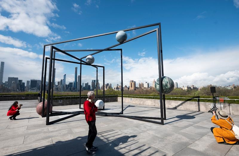 Alicja Kwade's installation on the roof of the Metropolitan Museum of Art in New York invites visitors to contemplate the solar system -- and how humankind fits into the universe (AFP Photo/Johannes EISELE)