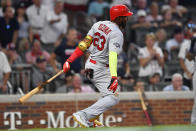St. Louis Cardinals left fielder Marcell Ozuna (23) hits a two RBI double against the Atlanta Braves in the ninth inning during Game 1 of a best-of-five National League Division Series, Thursday, Oct. 3, 2019, in Atlanta. The St. Louis Cardinals won 7-6. (AP Photo/John Amis)