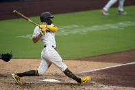 San Diego Padres' Eric Hosmer hits a grand slam during the fifth inning of a baseball game against the Texas Rangers, Thursday, Aug. 20, 2020, in San Diego. (AP Photo/Gregory Bull)