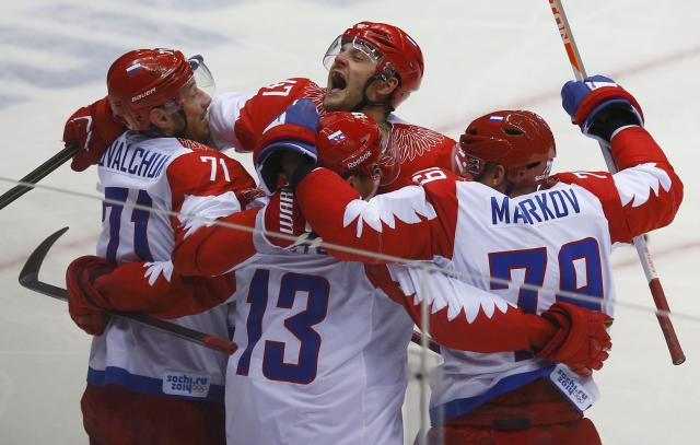 Russia's Pavel Datsyuk (13) celebrates his goal against Team USA with teammates Ilya Kovalchuk (L), Alexander Radulov (C) and Andrei Markov during the second period of their men's preliminary round ice hockey game at the Sochi 2014 Winter Olympic Games February 15, 2014. REUTERS/Brian Snyder (RUSSIA - Tags: SPORT ICE HOCKEY OLYMPICS)