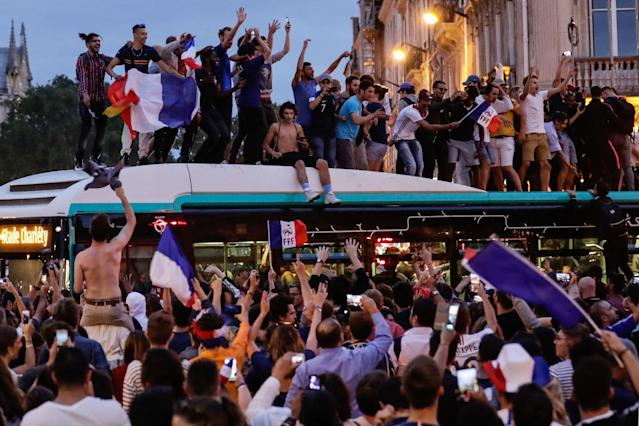 <p>People celebrate France's victory in central Paris on July 10, 2018 after the final whistle of the Russia 2018 World Cup semi-final football match between France and Belgium. (Photo by Thomas SAMSON / AFP) </p>
