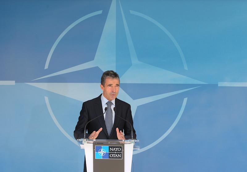 NATO Secretary General Anders Fogh Rasmussen addresses the media after he met with NATO ambassadors at NATO headquarters in Brussels, Tuesday, June 26, 2012. According to NATO, Syria's downing of a Turkish jet is 'unacceptable,' and NATO condemns 'it in the strongest terms'. (AP Photo/Yves Logghe)