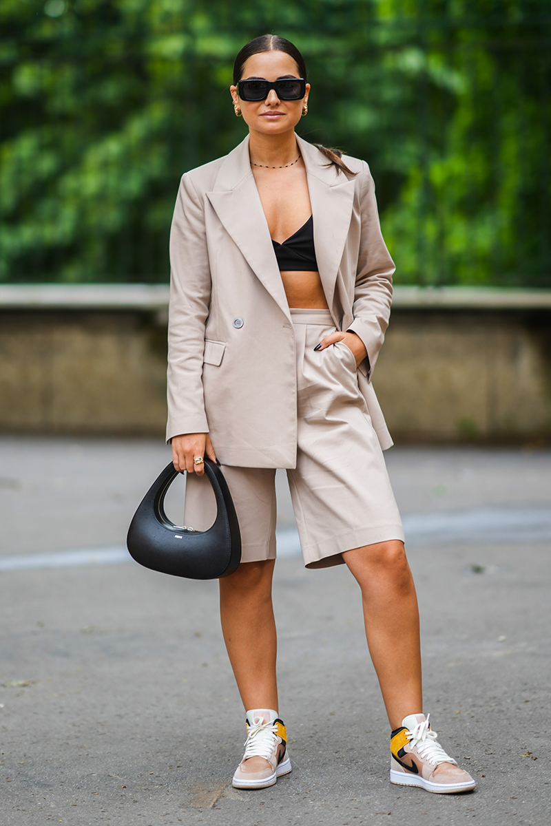 <p>Let's be honest, no summer work wardrobe is really complete without a short suit. Dress it down with a pair of trainers and add a crop top (or carry in your bag for a post-work outfit update) for desk to bar vibes.</p>