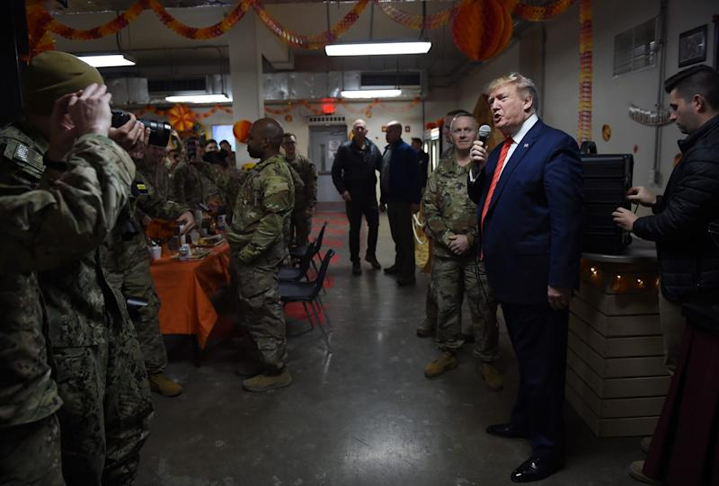 US President Donald Trump speaks to the troops before a Thanksgiving dinner at Bagram Air Field during a surprise visit on November 28, 2019 in Afghanistan.