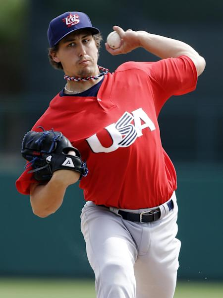 United States pitcher Derek Holland delivers against the Chicago White Sox in the first inning of an exhibition baseball game, Tuesday, March 5, 2013, in Glendale, Ariz. The game is the first of two exhibitions the U.S. will play leading up to the World Baseball Classic. (AP Photo/Mark Duncan)
