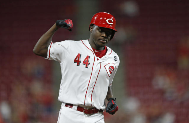 Cincinnati Reds' Aristides Aquino reacts as he rounds third base with a two-run home run off St. Louis Cardinals starting pitcher Adam Wainwright during the sixth inning of a baseball game, Friday, Aug. 16, 2019, in Cincinnati. (AP Photo/Gary Landers)
