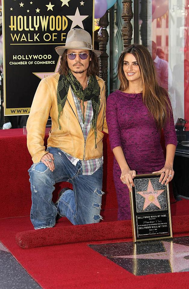 "Showing off her svelte post-baby bod, Penelope Cruz was honored with a star on the Hollywood Walk of Fame Friday in Los Angeles. Her ""Pirates of the Caribbean"" co-star, Johnny Depp, was on hand to help Cruz celebrate, as was her hubby, Javier Bardem. Frederick M. Brown/<a href=""http://www.gettyimages.com/"" target=""new"">GettyImages.com</a> - April 1, 2011"