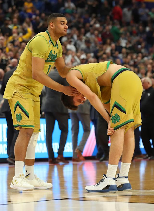 <p>Notre Dame forward Austin Torres (left) and Matt Ryan (right) react after their 83-71 loss to West Virginia in a second-round men's college basketball game in the NCAA Tournament, Saturday, March 18, 2017, in Buffalo, N.Y. (AP Photo/Bill Wippert) </p>