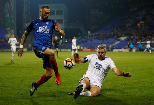 Soccer Football - FA Cup First Round Replay - Tranmere Rovers vs Peterborough United - Prenton Park, Birkenhead, Britain - November 15, 2017 Tranmere Rovers' Stephen McNulty in action with Peterborough United's Marcus Maddison Action Images/Jason Cairnduff