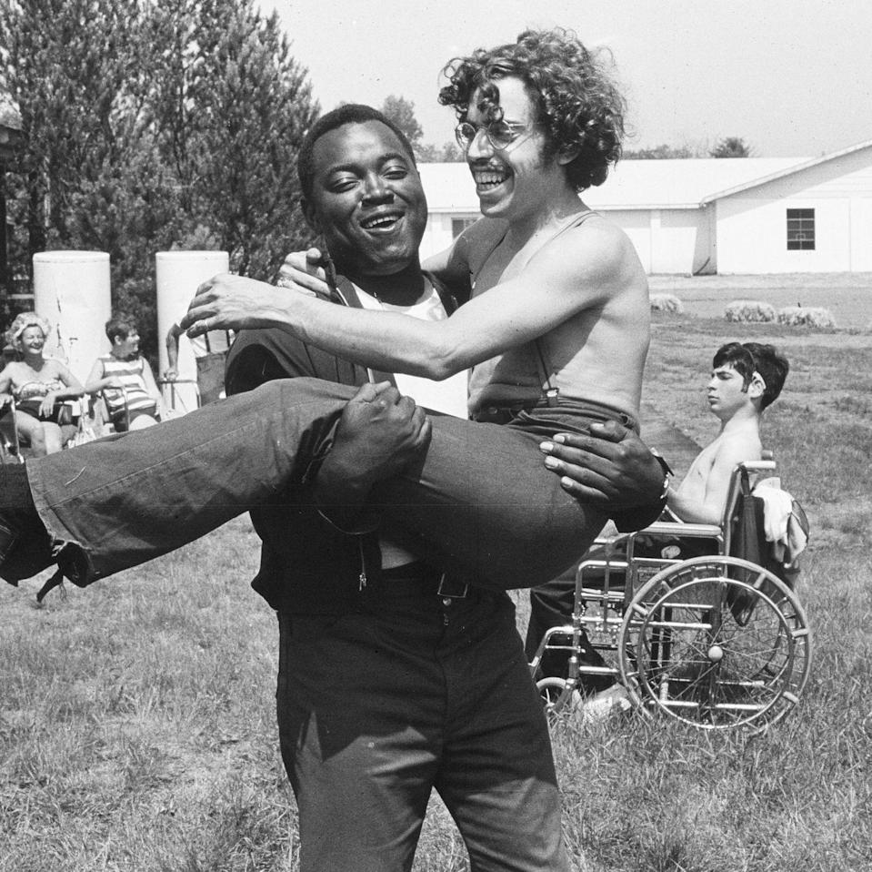 "<p><em>Crip Camp: A Disability Revolution </em>tells of the spirited and subversive history of Camp Jened in the 1970s. A camp based in the Catskills for young adults with developmental disabilities, Camp Jened became known for its liberating approach to fostering community and empowering its campers.</p><p><a class=""link rapid-noclick-resp"" href=""https://www.netflix.com/watch/81001496?trackId=13752289&tctx=0%2C0%2Cb093ea8a265b082bd5a5eab8d8654d8cec4f7515%3Af70503eebb62bf43b6d755df7202bd1f012f55ac%2C%2C"" rel=""nofollow noopener"" target=""_blank"" data-ylk=""slk:Watch Now"">Watch Now</a></p>"