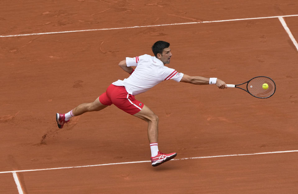 Serbia's Novak Djokovic plays a return to Italy's Lorenzo Musetti during their fourth round match on day 9, of the French Open tennis tournament at Roland Garros in Paris, France, Monday, June 7, 2021. (AP Photo/Michel Euler)