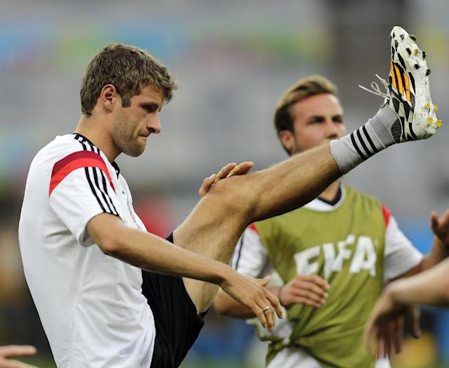 Germany's Thomas Mueller stretches during a training session one day ahead of the World Cup semifinal soccer match between Brazil and Germany at the Mineirao Stadium in Belo Horizonte, Brazil, Monday, July 7, 2014. (AP Photo/Frank Augstein)