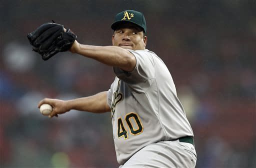 Oakland Athletics starting pitcher Bartolo Colon delivers against the Boston Red Sox during the first inning of a baseball game at Fenway Park in Boston on Tuesday, April 23, 2013. (AP Photo/Winslow Townson)
