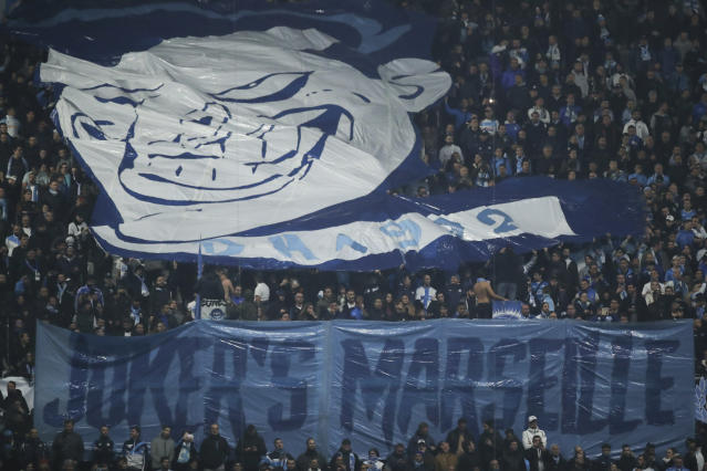 "Marseille fans hold a banner that reads ""joker's Marseille"" before the start of the French League One soccer match between Marseille and Bordeaux at the Velodrome stadium in Marseille, southern France, Sunday, Dec. 08, 2019. (AP Photo/Daniel Cole)"