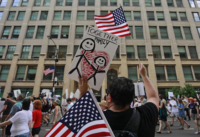 <p>Protestors march past offices of the US Immigration and Customs Enforcement (I.C.E.) during a demonstration against the US immigration policies separating migrant families in Chicago, June 30, 2018. (Photo: Jim Young/AFP/Getty Images) </p>