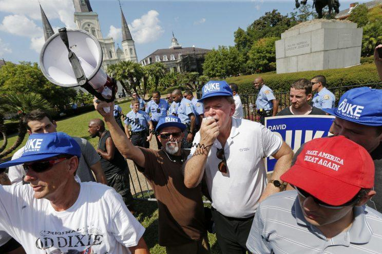 Former Ku Klux Klan leader David Duke, surrounded by a group of supporters, speaks in defense of a statue of Confederate Army General Andrew Jackson in New Orleans Saturday, Sept. 24, 2016. Duke, who lost his own campaign for the U.S. Tuesday, has been a vocal supporter of Donald Trump's bid for the White House. (Photo: Gerald Herbert/AP)