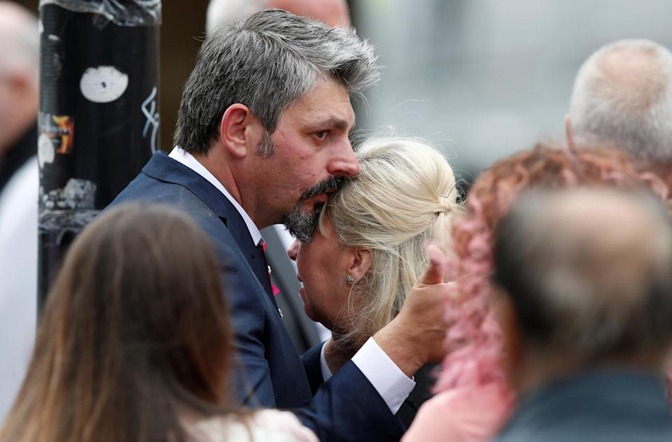 Lisa and Andrew Roussos, mother and father of Saffie Rose Roussos, the youngest victim of the bombing of the Manchester Arena, leave her funeral at Manchester Cathedral, Britain, July 26, 2017. REUTERS/Andrew Yates