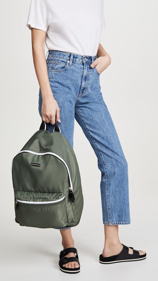 "<p>This <a href=""https://www.popsugar.com/buy/Paravel-Fold-Up-Backpack-555008?p_name=Paravel%20Fold%20Up%20Backpack&retailer=shopbop.com&pid=555008&price=65&evar1=savvy%3Aus&evar9=47291361&evar98=https%3A%2F%2Fwww.popsugar.com%2Fsmart-living%2Fphoto-gallery%2F47291361%2Fimage%2F47291449%2FParavel-Fold-Up-Backpack&list1=shopping%2Ctravel%2Cbags%2Cbackpacks%2Ctravel%20style%2Ctravel%20goods&prop13=mobile&pdata=1"" rel=""nofollow"" data-shoppable-link=""1"" target=""_blank"" class=""ga-track"" data-ga-category=""Related"" data-ga-label=""https://www.shopbop.com/fold-backpack-paravel/vp/v=1/1521454010.htm?folderID=13512&amp;fm=other-viewall&amp;os=false&amp;colorId=14936&amp;ref=SB_PLP_NB_51"" data-ga-action=""In-Line Links"">Paravel Fold Up Backpack</a> ($65) folds into a tiny square, so you can easily fit it in your suitcase when you're not using it.</p>"